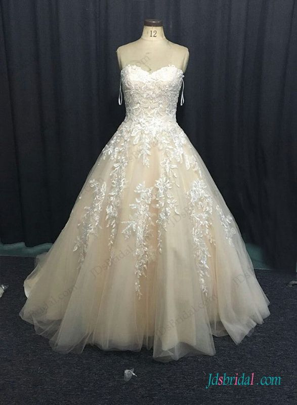 Sweetheart neck champagne colored ball gown wedding dress