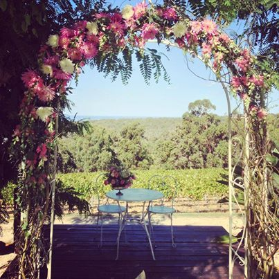 White Vintage Inspired Arch from Cape Of Love.Flower décor by Poppy+C-Flower Design.