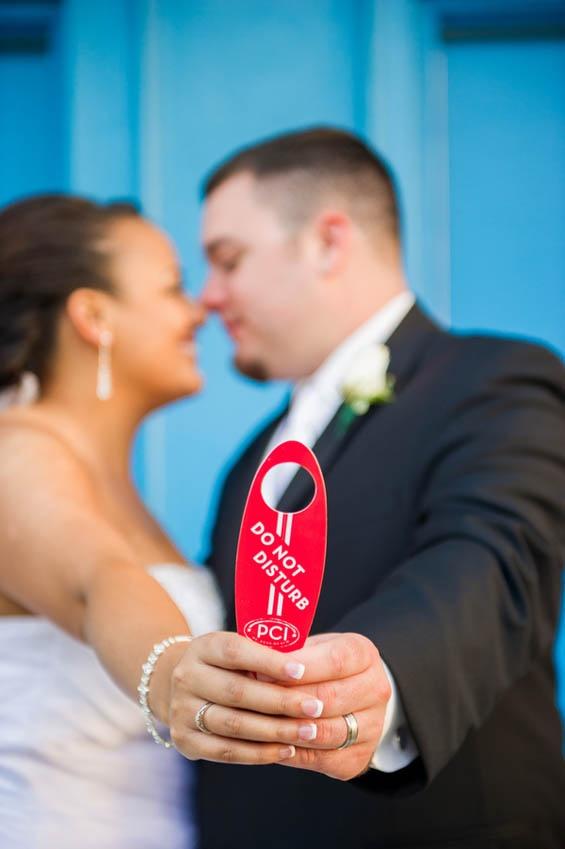 """The simplest wedding photo prop: your hotel room's """"Do Not Disturb"""" door sign!"""