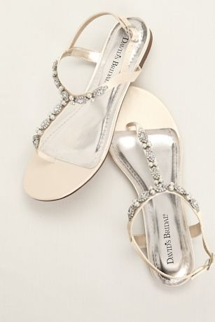 Pearl and crystal embellishment makes this t-strap sandal an elegant and comfortable option for any event!   Satin t-strap sandal encrusted with sparkling crystals and opulent pearls.  Heel Height: Flat.  Fully lined.  Imported.