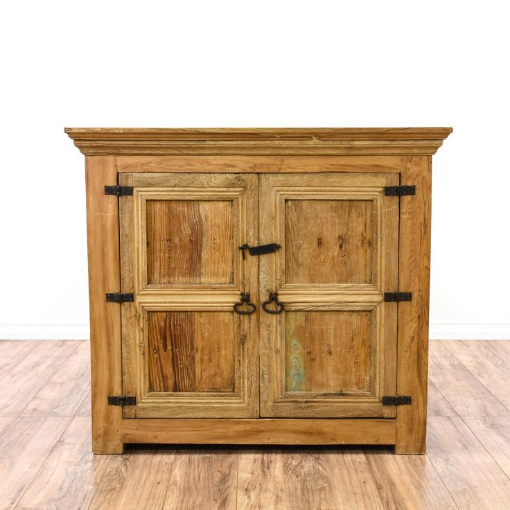 This media center is featured in a solid wood with a rustic light pine finish. This country farmhouse style cabinet has ample storage space, iron hardware and carved trim. Can also double as a mini bar! #countryfarmhouse #storage #cabinet #sandiegovintage #vintagefurniture