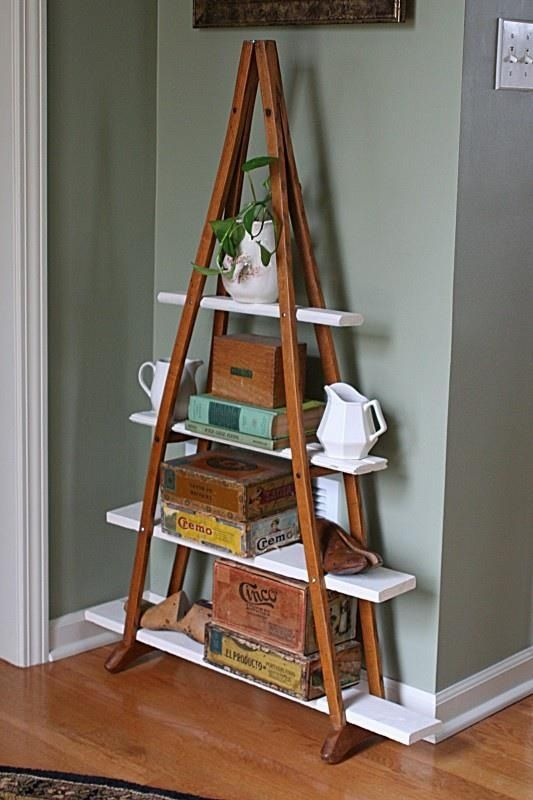 A pair of wooden crutches turned into a bookshelf.