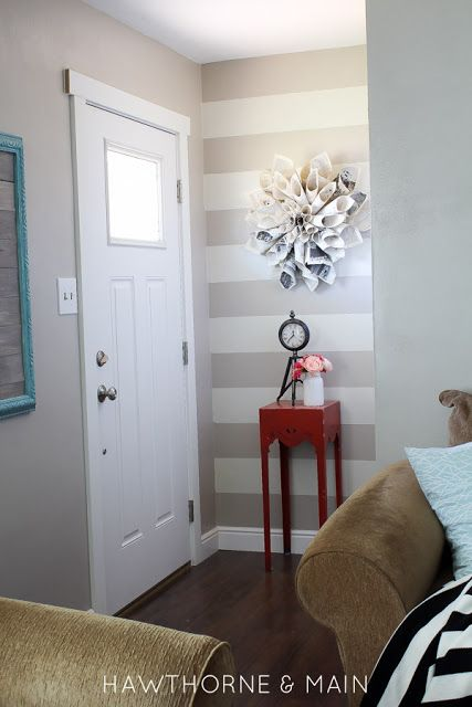 Beautifully updated entry way! I love the pop of color from the red table! I could totally do this!