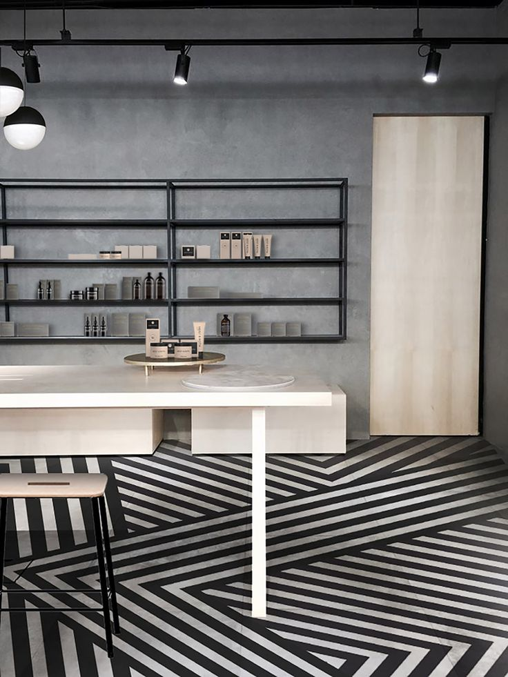 Wild 'n crazy striped floor design is pretty awesome. Facesss by Aurélien Barbry