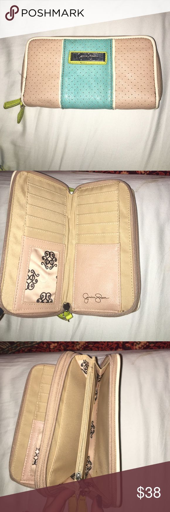 Jessica Simpson large 2 compartment wallet tan lime green and teal wallet with 2 zipper closures. leather & preforated! any questions please comment below :) id be glad to negotiate a price in your range😊 Jessica Simpson Bags Wallets
