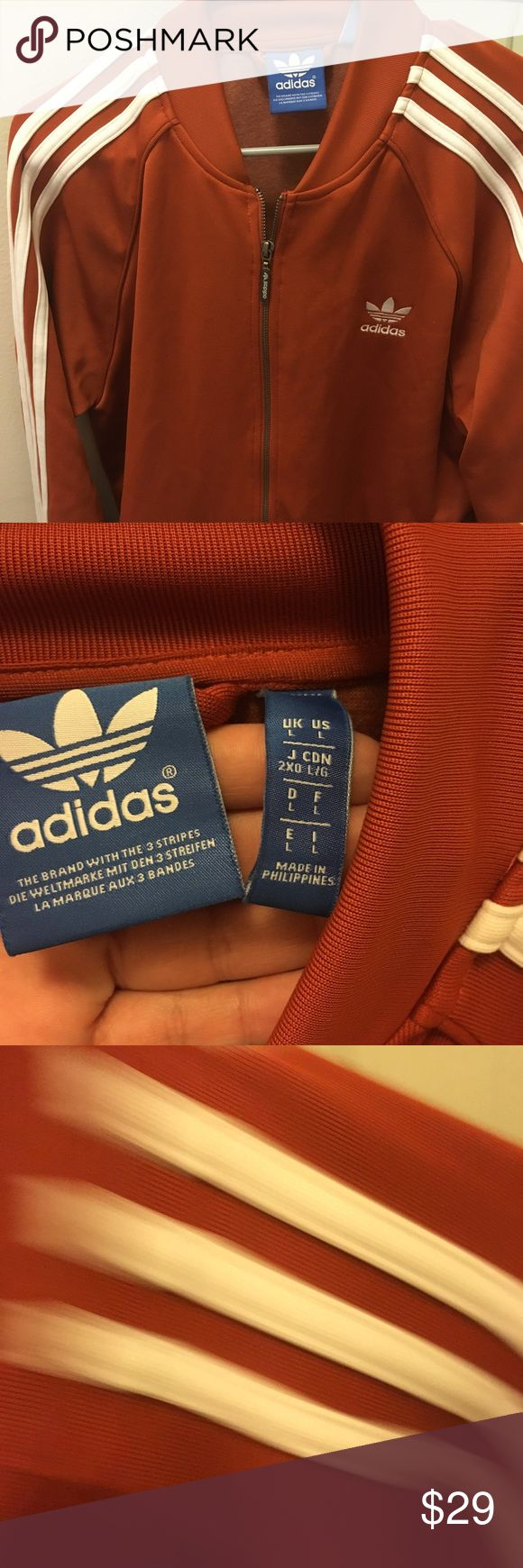 Adidas track jacket This is a light adidas jacket. It is a knit, not a windbreaker material. The color is a more of an orangey red. adidas Jackets & Coats