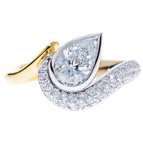 PEAR WITH SWEEPING PAVE ENGAGEMENT RING  Exquisite pear shape diamond rub-over set on an angle with a sweeping wrap-around pave band, gives this spectacular ring its movement. www.sdj.com.au