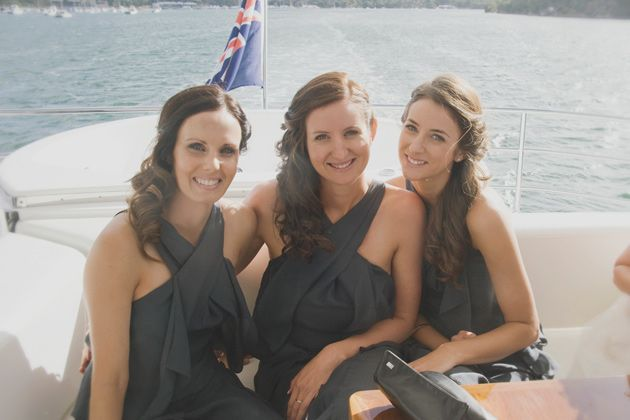 loving the bridesmaids twisted side hairstyles & floaty grey dresses at this chic yacht wedding