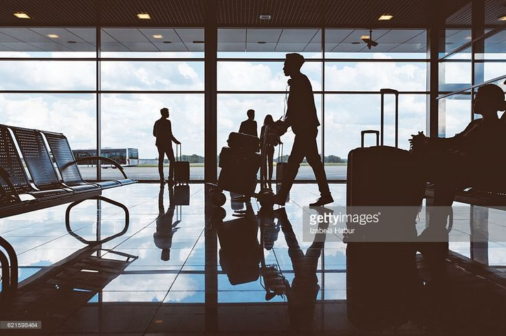 Stock Photo : Silhouette of people waiting at airport