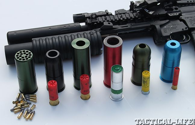 Updated and rail-mounted, Lewis Machine & Tool's M203 grenade launcher delivers flares, buckshot, .22s, high explosives and more!