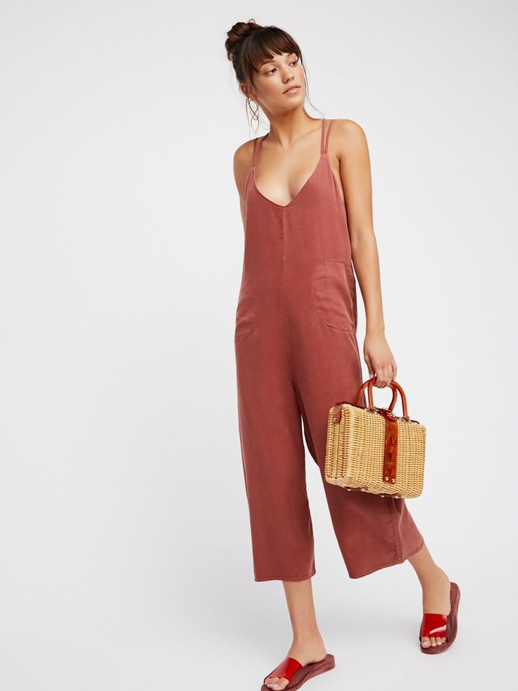 Wide Leg One-Piece   Easy and effortless soft jumpsuit features in a slouchy silhouette.    * Wide legs   * Ankle grazing inseam   * Hips pockets   * Low back   * Crisscross straps in back