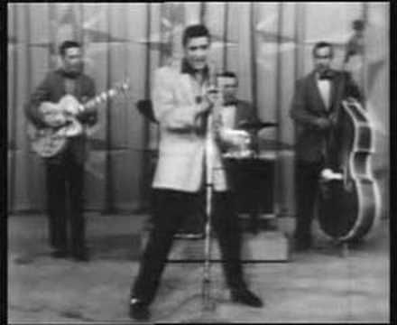 """January 8,1935: Elvis Presley is born in Tupelo, Mississippi. This is a video of Elvis performing his hit song, """"Hound Dog."""""""