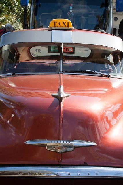vintage orange taxi, Havana, Cuba.  Photo: abaesel, via Flickr