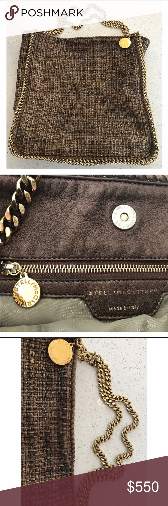 Stella McCartney Metallic Gold Boulce Tote Barely used 100% Authentic Stella McCartney Tote... gorgeous colors on the fabric.. extremely gently used.. tiny tarnish on gold.. not noticeable but must be mentioned.. For Sale Only Stella McCartney Bags Shoulder Bags