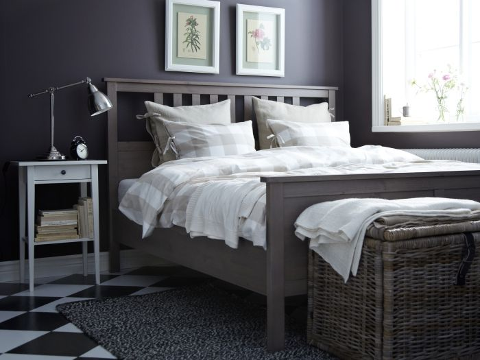 A trunk or chest at the foot of the bed, like BYHOLMA, is great for storing extra blankets and pillows.