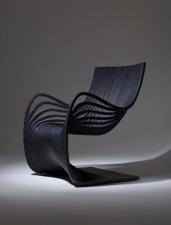 This nice chair with its soft shape is called Silla Pipo and is made only of wooden layers. Created by Piegatto.