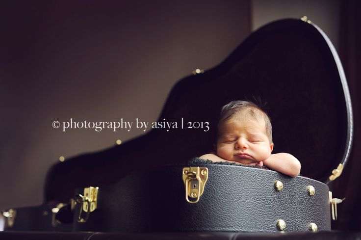 shadow and light perspective - baby in a guitar case