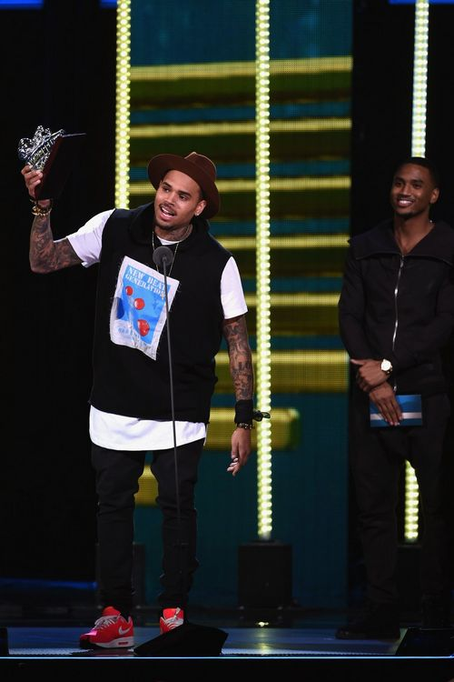 Chris Brown accepting an award from the #SoulTrainAwards - November 2014.