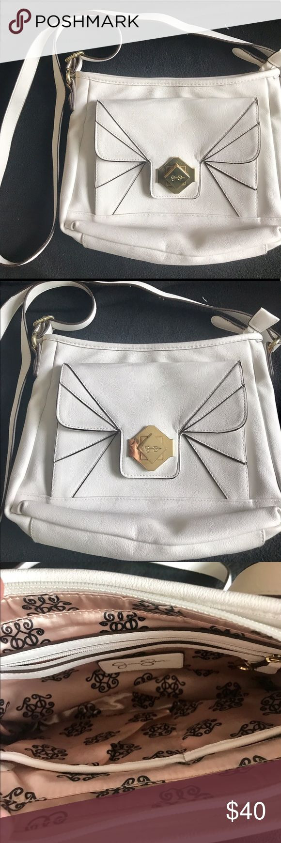"NWOT Jessica Simpson Cross Body Purse--White NWOT--Bought for a wedding but it didn't match my outfit, so it has never been used. White Jessica Simpson Cross Body Purse. Has front pocket with gold hardware & outside zipper pocket on other side. Purse has inside zipper pocket as well as 2 other pockets. PU material. 11"" W x 9"" H Jessica Simpson Bags Crossbody Bags"