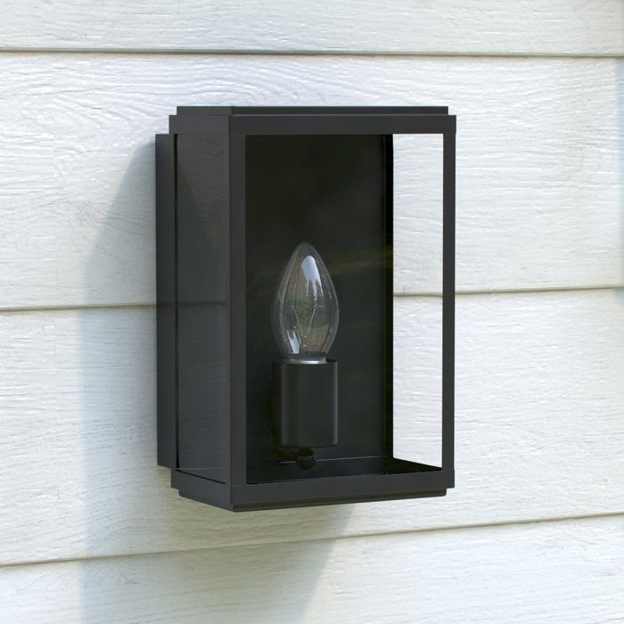 The perfect complement to your rustic patio scheme, this wall light features a lantern-style design. Complete the look with weathered wood patio furniture and natural stone paving.