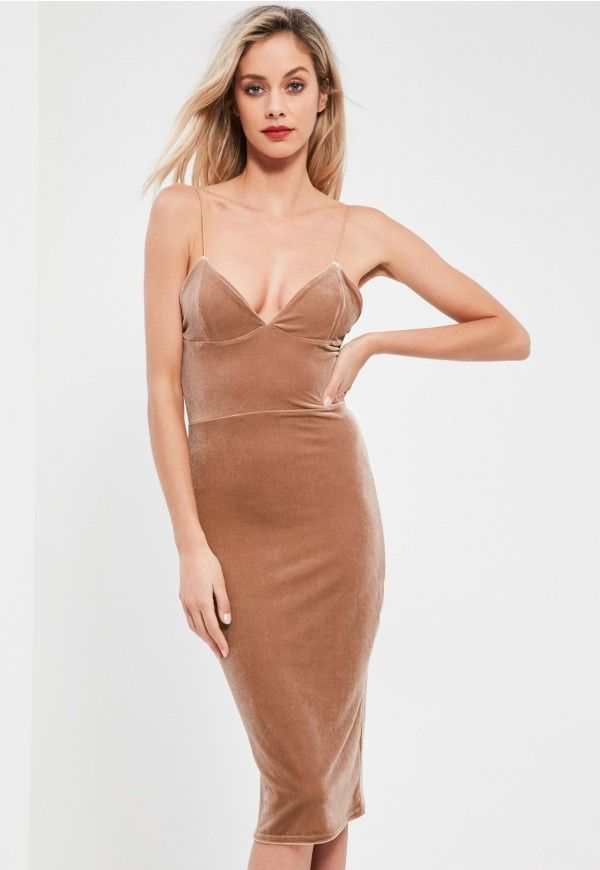 This nude dress has weekend goals all over it with its plunging v neckline and spaghetti straps.