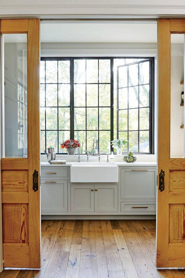 Sliding Doors into Gray Kitchen with Farmhouse Sink