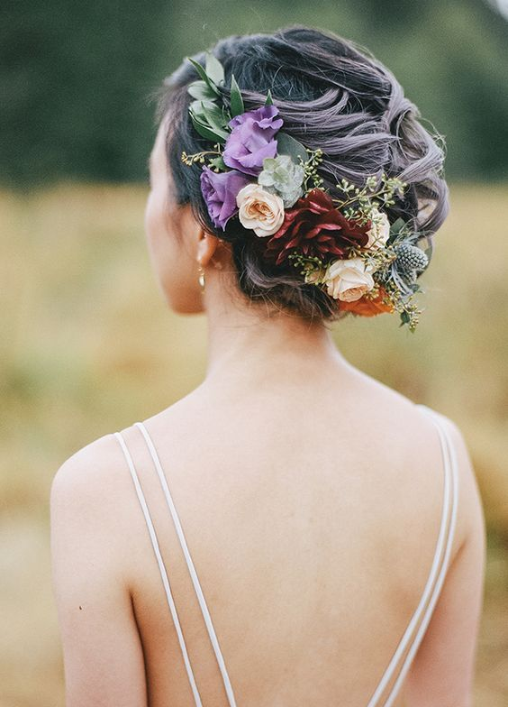 Bohemian chic flower crown updo wedding hairstyle; Featured Photographer: James Looker Photography