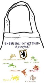 """Kochschürze """"Ein Berliner kleckert nicht - er dekoriert"""" mit typisch Berliner Flecken-die stadtmeister -  Geschenke mit Lokalkolorit & City-Souvenirs sowie dialektfreie und überregionale Geschenkideen zu jedem Anlass"""