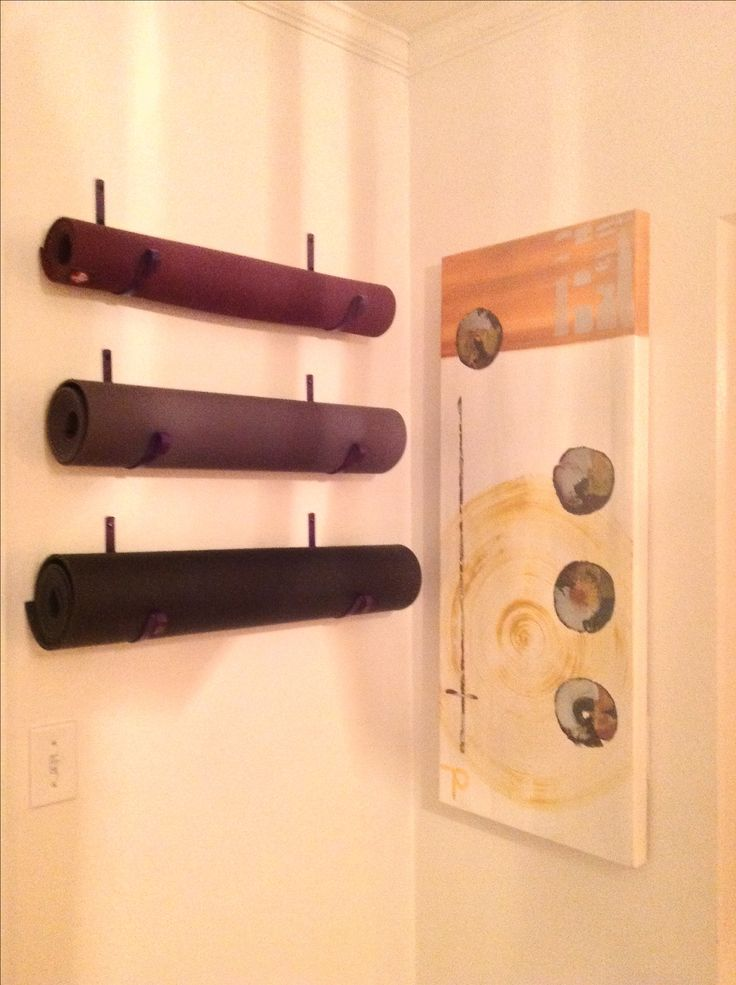 Needed a place to store my yoga mats. Plant hook, painted, turned upside down & mounted on my wall. Little proud of this one