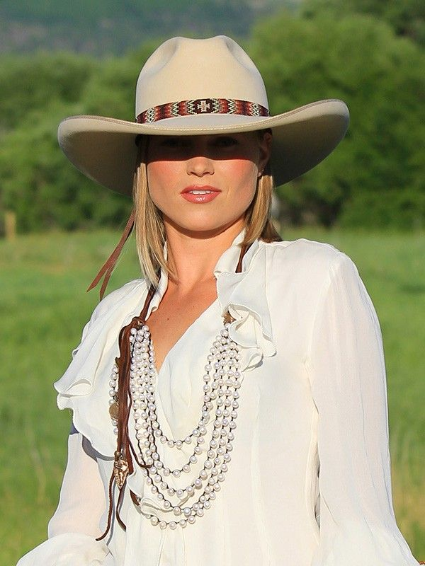 Being a Texan, I can certainly appreciate a little bit of that cowboy flair in her hat! Beautiful. (I actually don't usually like western-styled hats, but I love this one.)