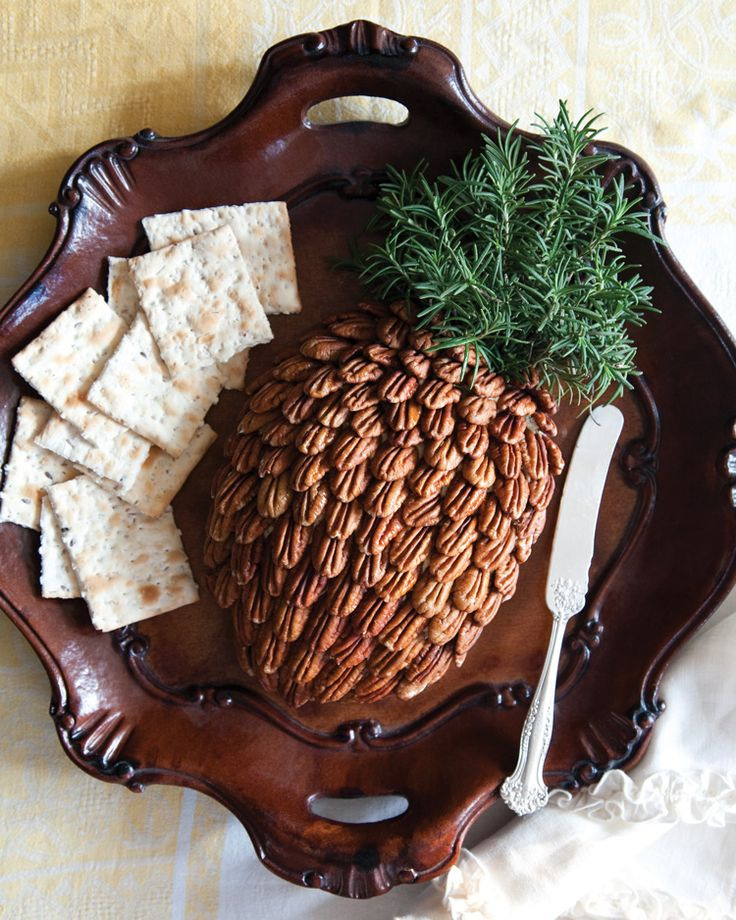 Add hospitable splendor to a table spread with Denise Gee's deliciously creative Charleston Cheese Ball. Find the full recipe and guide for artfully assembling this presentation-worthy pineapple here!