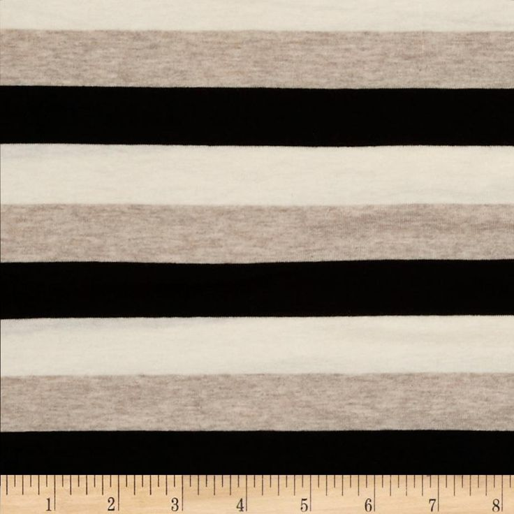 Designer Stretch Stripe Jersey Knit Tan/Black/Cream from @fabricdotcom  This jersey knit fabric has a soft  hand, fluid drape and about 50% four way stretch. This versatile fabric is perfect for creating stylish tops, tanks, lounge wear, gathered skirts and fuller dresses with a lining. It features horizontal yarn dyed stripes of oat, cream and black.