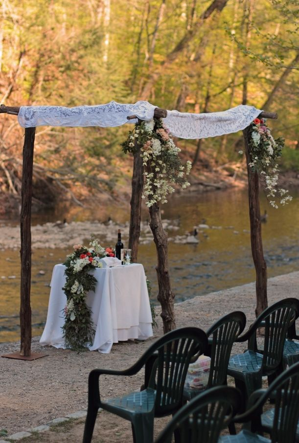 Rustic creek side alter at outdoor wedding.