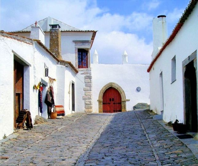 Top 25 Attractions & Things To Do In Portugal - via Open Travel | Portugal has everything you need plus a bunch of things to surprise you. The emerald waters of Algarve, the red-tiled roofs of Madeira, the soothing whiteness of Belem and the luscious greenness of the Azores are all for the taking. And so is the tranquility Alentejo's sleepy fishing villages, the rambling of trams in the narrow, ascending streets of Lisbon... Photo: Monsaraz
