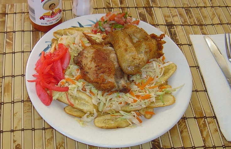 Tajada De Guineo Verde con Pollo Frito - Honduran fried chicken with fried green banana slices, chimol (similar to pico de gallo), curtido (pickled veggies).