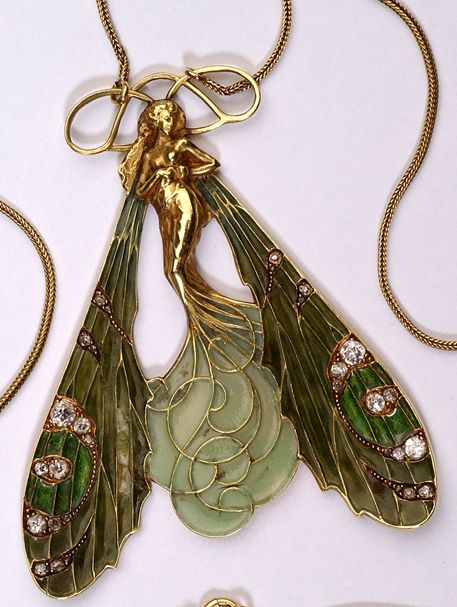 An Art Nouveau dragonfly woman pendant, by René Lalique. Gold, diamond, plique-à-jour enamel.
