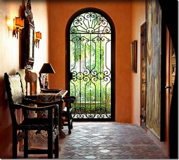 Wrought Iron Door :: Mediterranean Design: Rather than carpeting the floors with exquisite rugs, Spanish folks prefer to choose hard flooring. Terracotta tiles, ceramic tiles or hardwood flooring go very well with Spanish style décor. If you still want to throw down a carpet for a cozier look, make sure to pick it in vibrant colors and ethnic styles