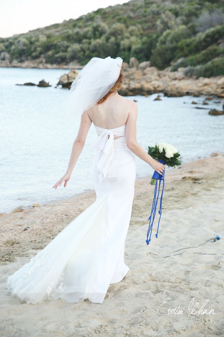 a bride walking on the beach