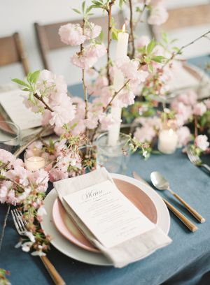 Get inspired to infuse your celebration with the prettiest Spring blooms a la this gorgeous inspiration. Cherry blossoms are incorporated into everything from the tablescape to the stunning dress.