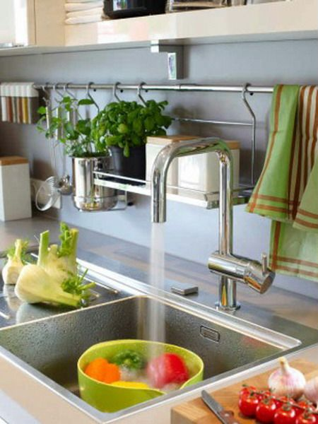 Counter built deep enough to allow for this rack and items hanging over the sink area to not interfere.  Like the hanging shelf elevating items off of a potentially wet area.