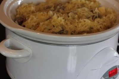 Sausage, sauerkraut, and potatoes cooked in the slow cooker. Easy and delicious!