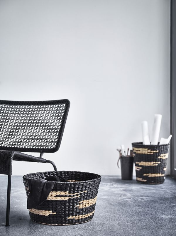 Working with natural fibre from water hyacinth, Ingegerd Råman designed two large, patterned baskets in black and light brown - part of the IKEA VIKTIGT limited collection.