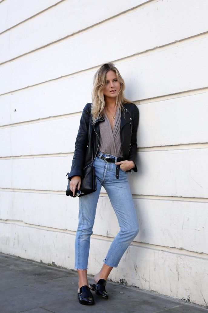 The Best Blogger Street Style for Spring Outfit Inspiration | 'Fashion Me Now' blogger in black leather moto jacket, wrap blouse, cropped jeans, and loafers