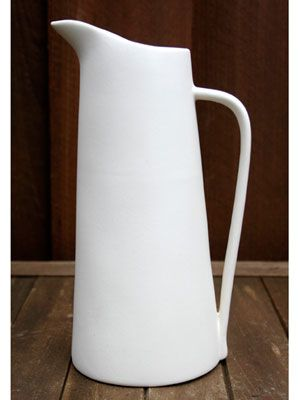 1953 Ceramic Pitcher $1,500  Crafted by sculptor n ceramist Malcolm Leland & appears in 1953 catalog of his work. He won a Good Design honor from the Museum of Modern Art (for his gourd-shaped birdhouse) in 1955—the same year he closed his Co. to pursue projects & work for a larger pottery studio. Pieces issued under his own label are hard to come by, especially oft-used household items like this. Very desirable-collectors pay $1,000 to $2,000 for this piece, which cost under two dollars.