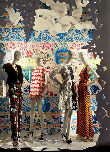 A Bergdorf Goodman window display featuring artwork by Sean Slaney. #retail #merchandising #window_display #paper