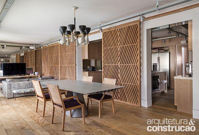Revista Arquitetura e Construção - Despertar de sensações: madeira de demolição, treliças e iluminação cênica dão vida a este apê