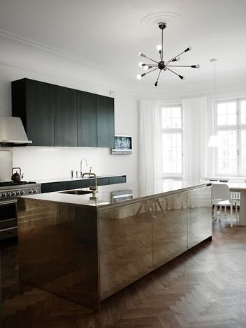 polished stainless steel kitchen island, matte black cabinet paint, white walls, #kitchen, herringbone wood floor, #interiors, chandelier, interior design