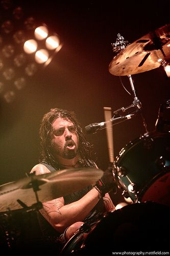 Dave Grohl -- if you're gonna kick ass, you have to be willing to sweat, and to let your face go to the strange places where make-up doesn't matter, and pretty doesn't matter - you have to be willing to EXPRESS like mad.