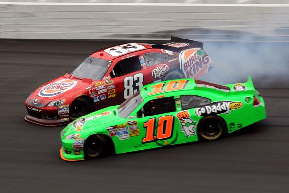 Danica Patrick Photos Photos - Landon Cassill, driver of the #83 Burger King Toyota, and Danica Patrick, driver of the #10 GoDaddy.com Chevrolet, spin after an incident in the NASCAR Sprint Cup Series Hollywood Casino 400 at Kansas Speedway on October 21, 2012 in Kansas City, Kansas. - Hollywood Casino 400