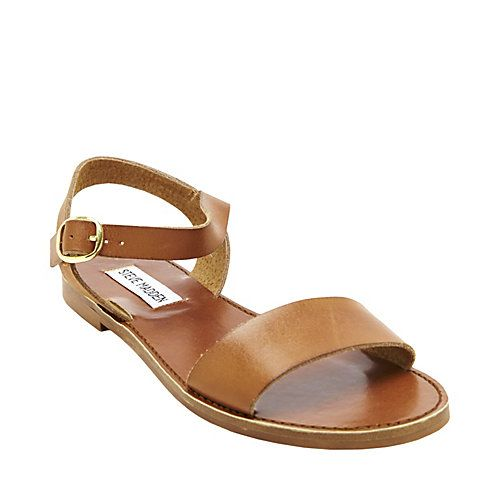 the clean, uncluttered look of the Donddi flat sandals from Steve Madden  bring a sleek sophistication to whatever you pair them with.